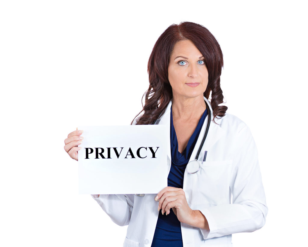 Doctor holding sign for privacy for HIPAA compliance blog post for professional printing with Artisan Colour
