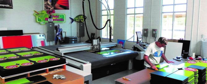 custom printing services AC sign being cut with Zund router